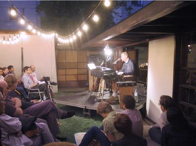 "*Stephen Prina performing ""Sonic Dan"" for the ""Sound"" series at the Schindler House,* Los Angeles, August 25, 2001."