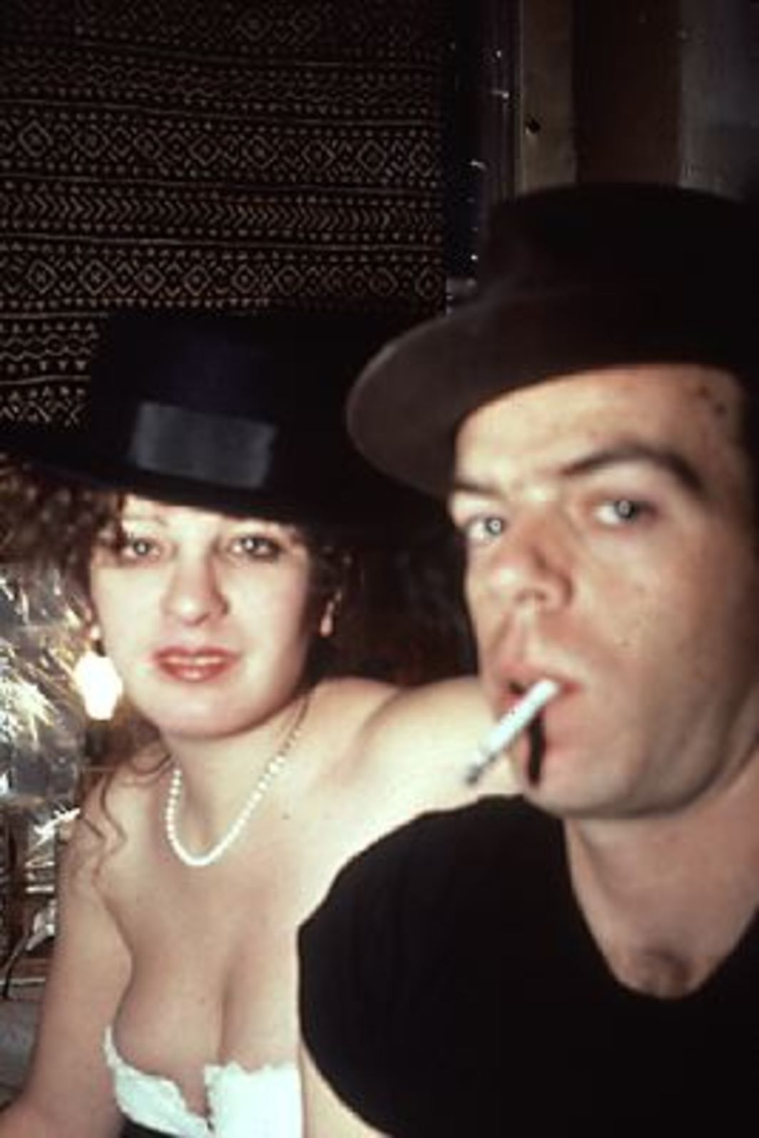 Nan Goldin, Self-portrait with Brian in hats, NYC, 1983, color slide. From The Ballad of Sexual Dependency.