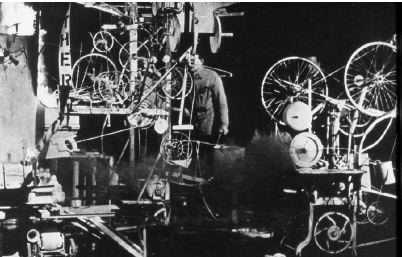 Billy Klüver preparing Jean Tinguely's Homage to New York, Museum of Modern Art, New York, 1960. Photo: David Gahr.