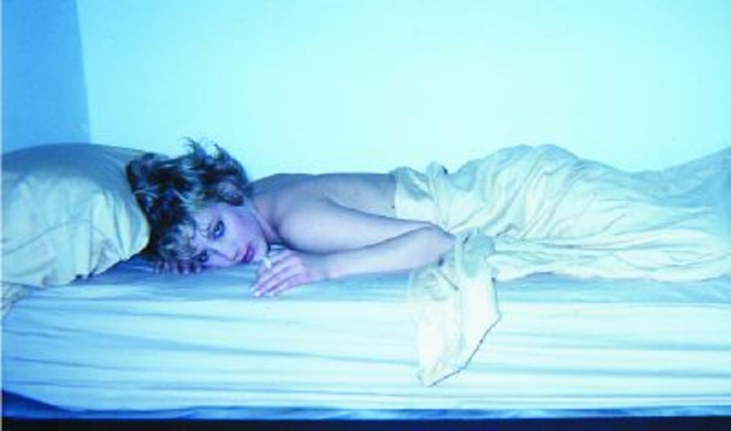 "Chason Matthams, Girl on bed, NYC, 2003, color photograph, 6 x 9 3/4""."
