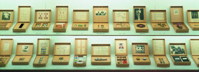 Susan Hiller, From the Freud Museum (detail), 1991–1997, artifacts, notes, cardboard boxes, vitrine, and video projection, dimensions variable.