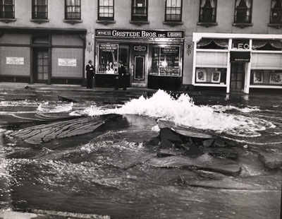 "Weegee, Watermain Burst Uproots Madison Avenue, ca. 1940, black-and-white photograph, 6 3/4 x 8 6/16"". © Weegee/International Center of Photography."