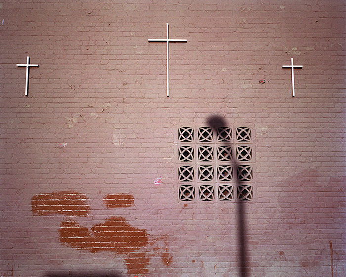 "Catherine Opie, Three Crosses and a Shadow, 2005, color photograph, 16 x 20""."