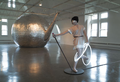 "View of Mai-Thu Perret, ""And every woman will be a walking synthesis of the universe,"" Renaissance Society, Chicago, 2006. From left: Mai-Thu Perret, Little Planetary Harmony, 2006; Mai-Thu Perret with Ligia Dias, Apocalypse Ballet (Three White Rings), 2006."