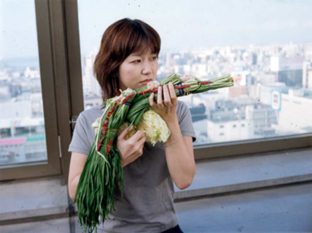 "Tsuyoshi Ozawa, Giblets Hot Pot/Fukuoka, 2002, color photograph, 45 x 61 3/4"". From the series ""Vegetable Weapon"" (2001–). From Asia-Pacific Triennial of Contemporary Art 5."