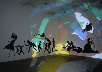 "Kara Walker, Darkytown Rebellion, 2001, projection, cut paper and adhesive on wall, 14 x 37""."