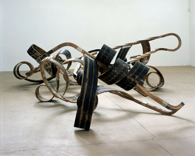 "Richard Deacon, Out of Order, 2003, steamed oak, stainless steel, and screws, 6' 3"" x 23' x 18' 8 1/2""."