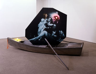 "Lothar Hempel, Endless Journey, 2006, boat, drinks, photographic paper, lamps, 6' 7 15/16"" x 3' 8 7/8"" x 10' 7 15/16""."