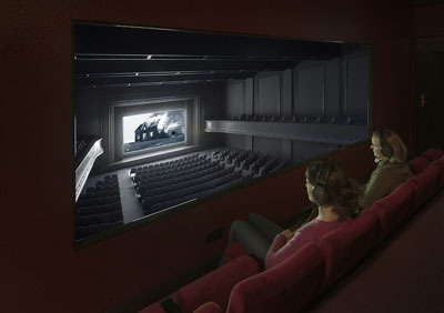"Janet Cardiff and George Bures Miller, The Paradise Institute, 2001, wood, theater seats, DVD, DVD player, digital projector, headphones, and mixed media, 10' x 37' 5"" x 16' 9""."