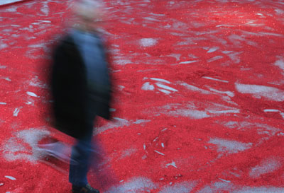 Liam Gillick, The Hopes and Dreams of the Workers as They Wandered Home from the Bar, 2004, red glitter. Installation view, Palais de Tokyo, Paris, 2005.