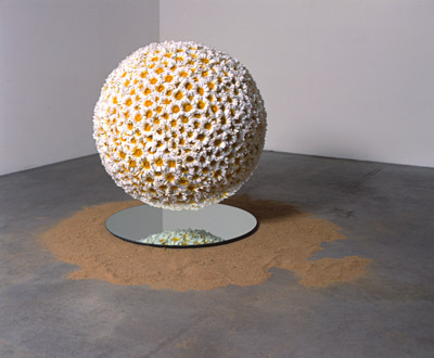 "John Miller, Imaginary Friend, 1999, artificial flowers, Styrofoam sphere, monofilament, sand, and mirror, 36 x 36 x 36""."