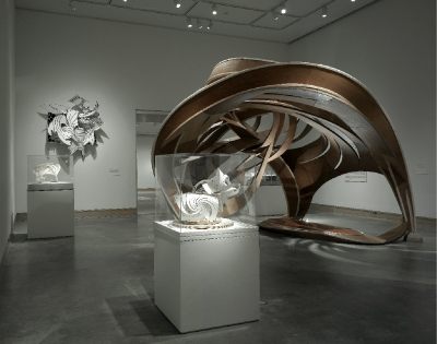 "View of ""Frank Stella: Painting into Architecture,"" 2007, Metropolitan Museum of Art, New York. Foreground, Gate House (Model), 1994. Background, from left: The Broken Jug (Model), 1998; The Dart (D-15) 1X, 1990; and The Broken Jug (Left-Handed Version), 2007. All works by Frank Stella © Frank Stella/Artists Rights Society (ARS), New York."
