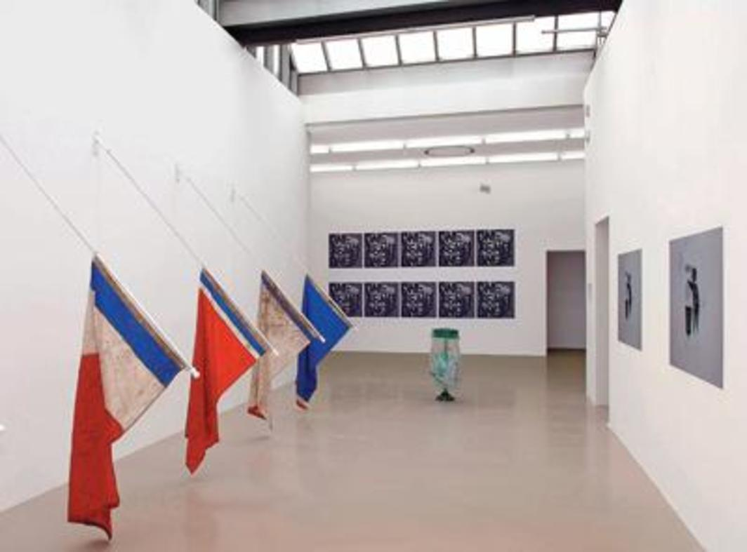 View of Biennale de Lyon 2007, Musée d'Art Contemporain, Lyon. Left: Claire Fontaine, Untitled (identité, souveraineté et tradition), 2007. Photo: Blaise Adilon.