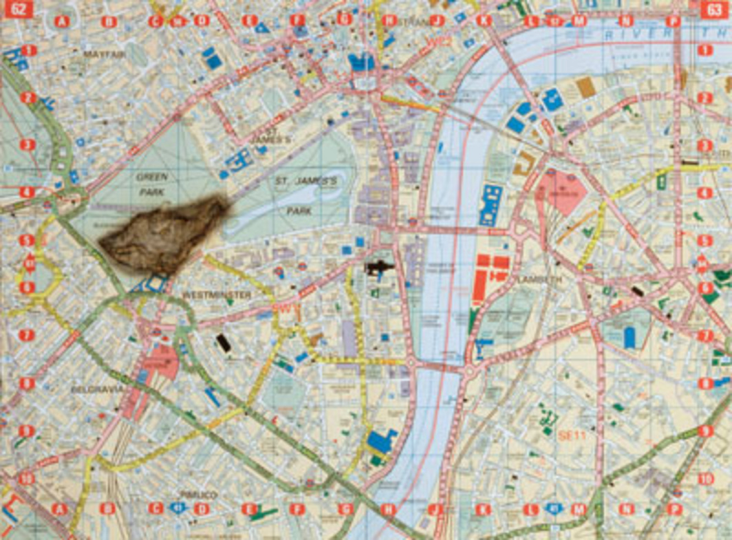 "Cornelia Parker, Meteorite Lands on Buckingham Palace, 1998, maple-box-framed map of London and burn left by meteorite, 21 1/4 x 27 1/6""."