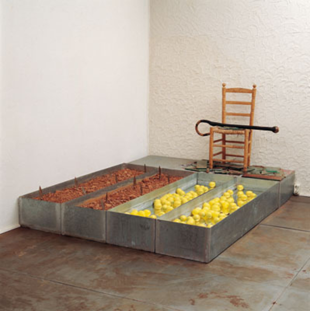 "Wolf Vostell, view of Garcia Lorca, 1986, zinc, lemons, knives, chair, earth, drinks, 118 1/8 x 118 1/8 x 63""."