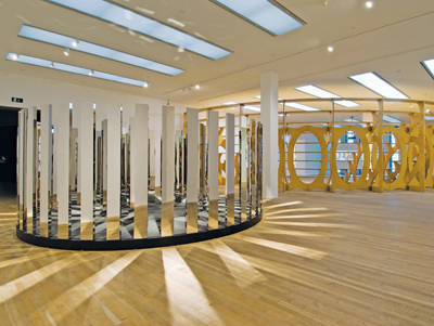 "View of ""The World as a Stage,"" 2007, Tate Modern, London. Foreground: Jeppe Hein, Rotating Labyrinth, 2007. Background: Rita McBride, Arena, 1997–2006."