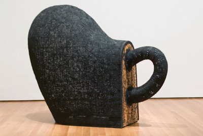 "Martin Puryear, Dumb Luck, 1990, wire mesh, tar, and wood, 64 x 94 x 36""."