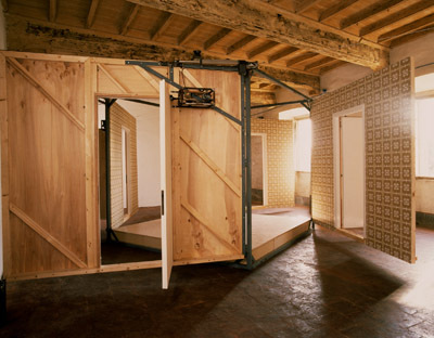 Paul McCarthy, Bang-Bang Room, 1992, wood, steel, electric motors, linoleum, and wallpaper, dimensions variable.