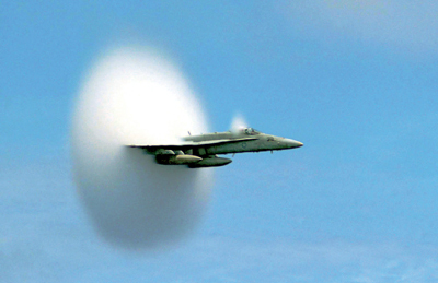 Illustration from Sanford Kwinter's Far from Equilibrium: Essays on Technology and Design Culture. United States Navy FA-18C Hornet breaking the sound barrier over the Pacific Ocean, July 7, 1999. Photo: John Gay/US Navy.