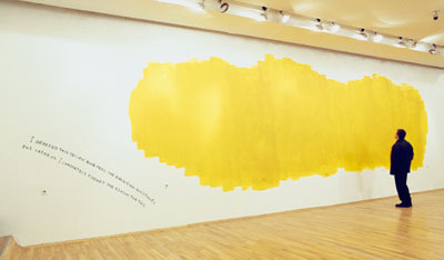 "Nedko Solakov, The Yellow Blob Story, 1997, yellow paint and handwritten text on wall. Installation view, Sofia City Art Gallery, Sofia, Bulgaria. From ""The Absent-Minded Man"" project."