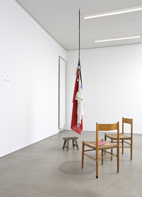 Geoffrey Farmer, It is not worth the bother of killing yourself, since you always kill yourself too late, 2008, modified rifle cleaner, wooden stool, and various signs, dimensions variable.