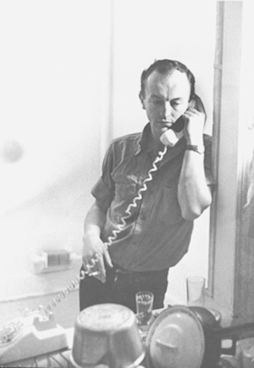 Frank O'Hara in his home, New York, 1965. Photo: Mario Schifano. Courtesy the Estate of Joe LeSueur.