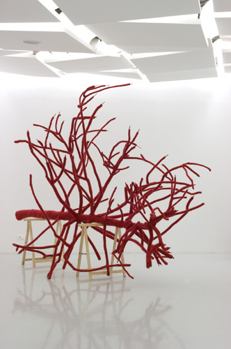 Ludivine Caillard, A Red Dress for a Tree, 2008, tree, wool. Installation view, 2009.