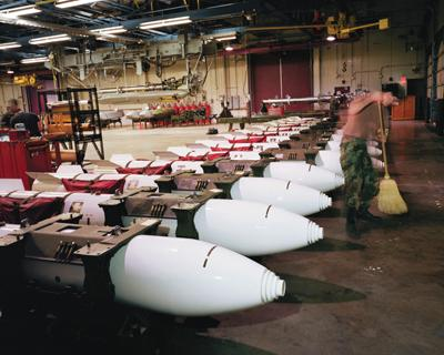 "Paul Shambroom, B83 one-megaton nuclear gravity bombs in Weapons Storage Area, Barksdale Air Force Base, Louisiana, 1995, color photograph, 48 x 61"". From the series ""Nuclear Weapons,"" 1992–2001."