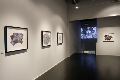 "View of ""Cassandra C. Jones,"" 2009. From left: Lightning Drawing I, 2009; Swarm, 2009; Iris, 2009; Disco Ball, 2009; Lightning Drawing II, 2009."