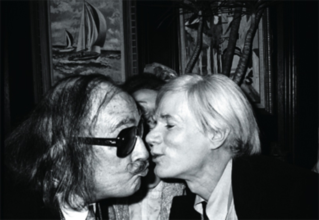 "Christopher Makos, Dalí Kissing Andy, 1978, black-and-white photograph, 16 x 20""."