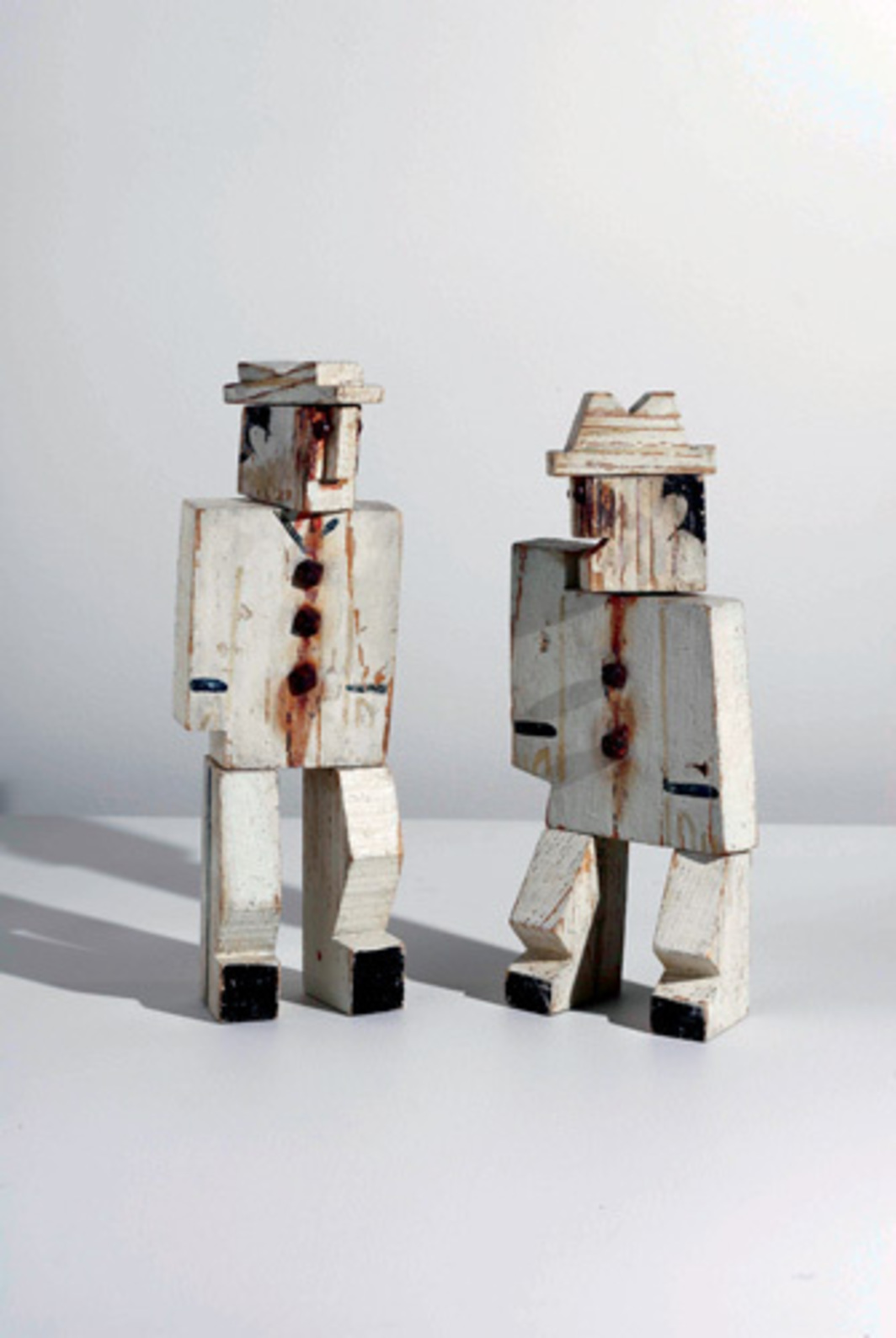 "Joaquín Torres-García, Two White Men, ca. 1929, oil and iron tacks on wood, two parts, from left: 10 1/4 x 3 1/2 x 3/4"", 8 3/4 x 3 x 3/4""."