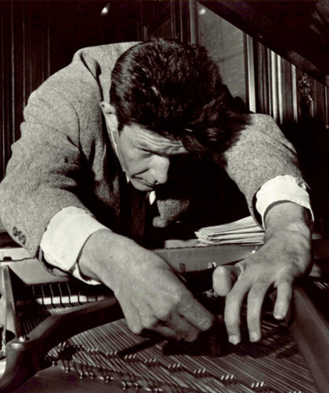 John Cage preparing a piano, ca. 1950. Photo: Merce Cunningham Dance Company.