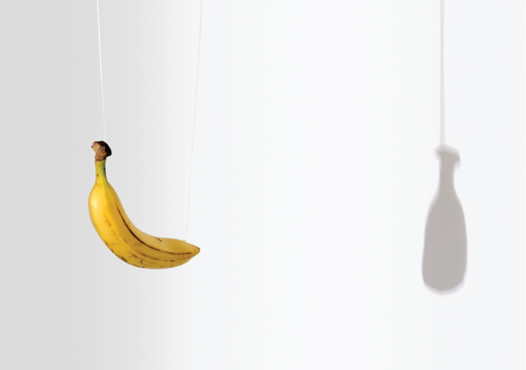 Urs Fischer, Untitled, 2003, nylon filament, banana, theater spotlight, dimensions variable.