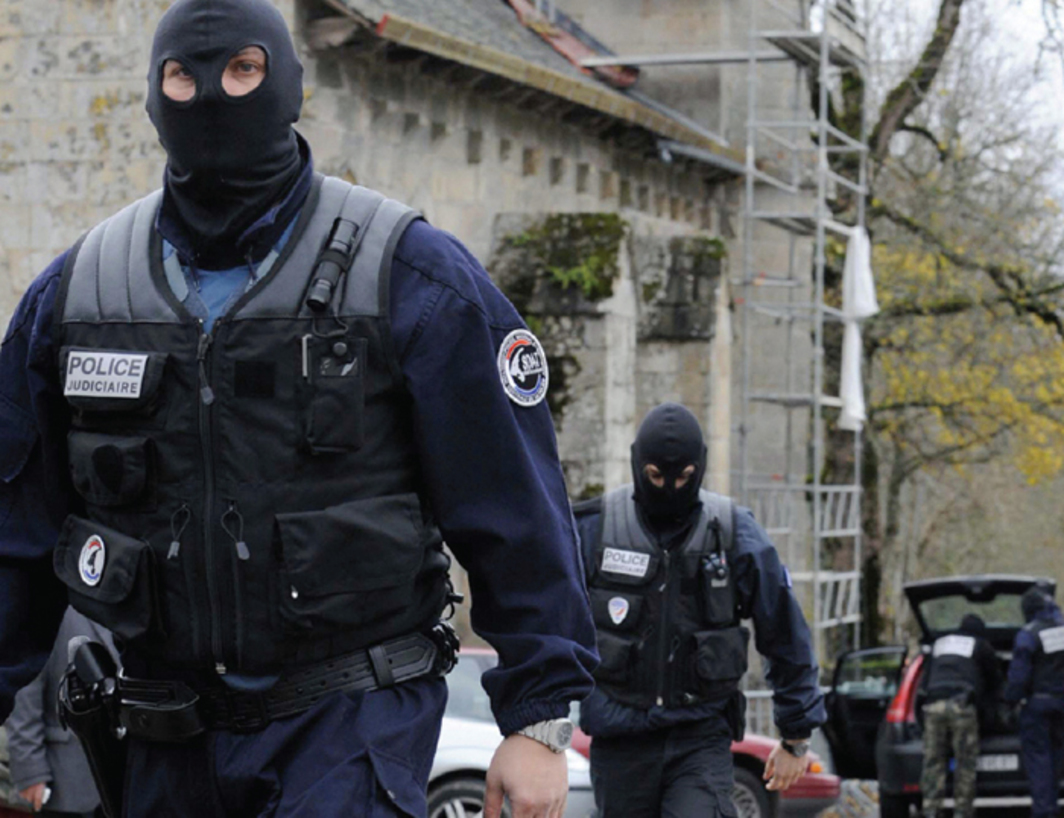 Police officers patrolling the streets of Tarnac, France, November 11, 2008. Photo: Thierry Zoccolan/Getty Images.
