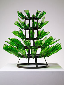 "Kendell Geers, Rack, 2009, metal, beer bottles, 28 x 29 x 29""."
