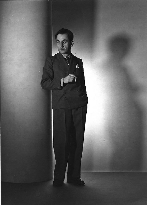 "Man Ray, Self-Portrait as a Fashion Photographer, 1936, black-and-white photograph, 8 1⁄4 x 6"". All works by Man Ray © 2010 Man Ray Trust/Artists Rights Society (ARS), New York/ADAGP, Paris."