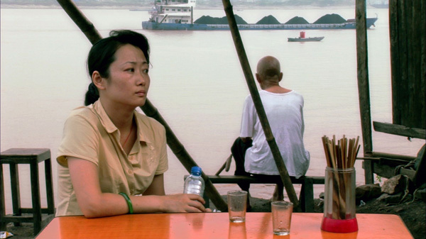 Jia Zhangke, Still Life, 2006, still from a color film in HD, 111 minutes. Shen Hong (Zhao Tao).