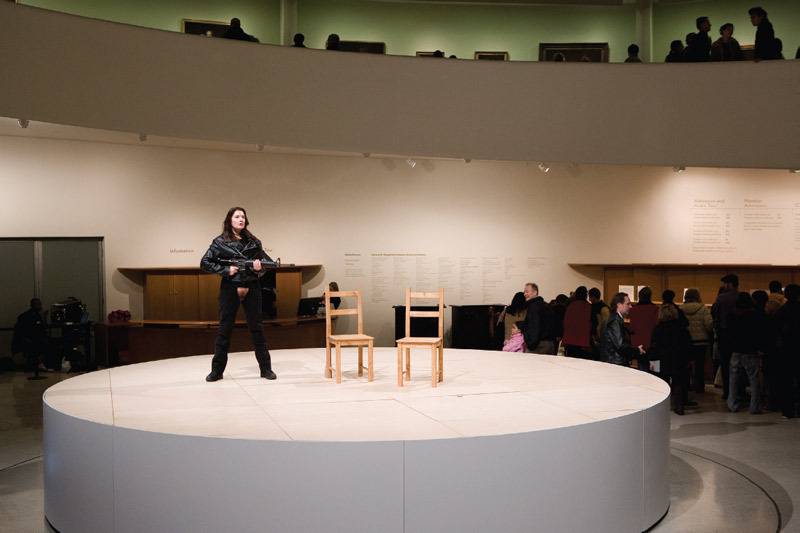 Marina Abramović, Seven Easy Pieces, 2005. Performance view, Solomon R. Guggenheim Museum, New York, November 11, 2005. Abramović performing Valie Export's Action Pants: Genital Panic, 1969/2001. Photo: Kathryn Carr.