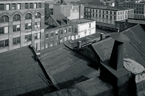 "Danny Lyon, View west from a Washington Street rooftop, 1967, black-and-white photograph, 9 x 11 1/2"". From the series ""The Destruction of Lower Manhattan,"" 1966–67."