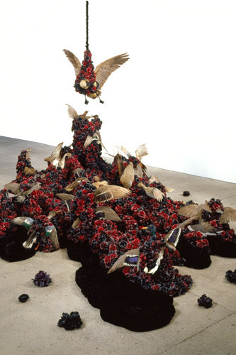 Petah Coyne, Untitled #1240 (Black Cloud), 2007–2008, taxidermy birds, silk flowers, silk/rayon velvet, plaster statuary, feathers, wax, cables, cable nuts, paint, plaster, metal, felt, pearl-headed hat pins, pigment, thread, wood, vinyl, dimensions variable.