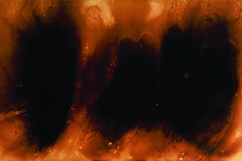 "Yves Klein, Untitled Fire Painting, ca. 1961, scorched paper on fiberboard on panel, 51 1/4 x 98 1/2""."
