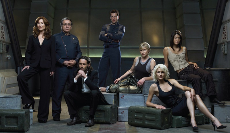 "Battlestar Galactica, 2003–2009, still from a TV show on Syfy. From left: President Laura Roslin (Mary McDonnell), Admiral William Adama (Edward James Olmos), Dr. Gaius Baltar (James Callis), Lee ""Apollo"" Adama (Jamie Bamber), Kara ""Starbuck"" Thrace (Katee Sackhoff), Number Six (Tricia Helfer), and Number Eight (Grace Park)."