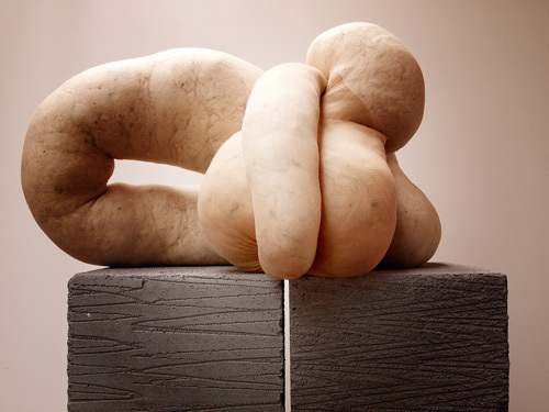 "Sarah Lucas, NUD CYCLADIC (16), 2010, tights, fluff, wire. Sculpture: 11 3/4 x 19 1/4 x 13"". Plinth: 16 7/8 x 16 7/8 x 16 7/8""."