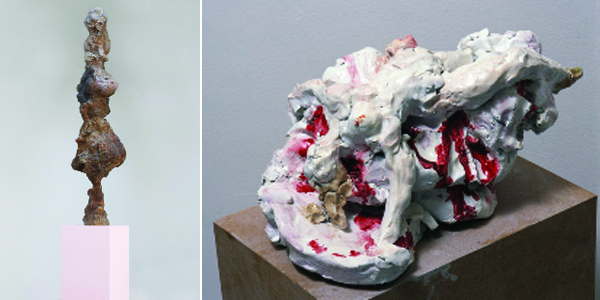 "Left: Rebecca Warren, The Main Feeling, 2009, handpainted bronze on painted MDF plinth, 114 x 30 x 28 1/2"". Plinth: 64 x 26 3/8 x 26 3/8"". Right: Rebecca Warren, Mord, 2002, handpainted reinforced clay on MDF plinth, 7 1/2 x 15 3/4 x 8 1/4"". Plinth: 43 1/4 x 29 1/8 x 29 1/8""."