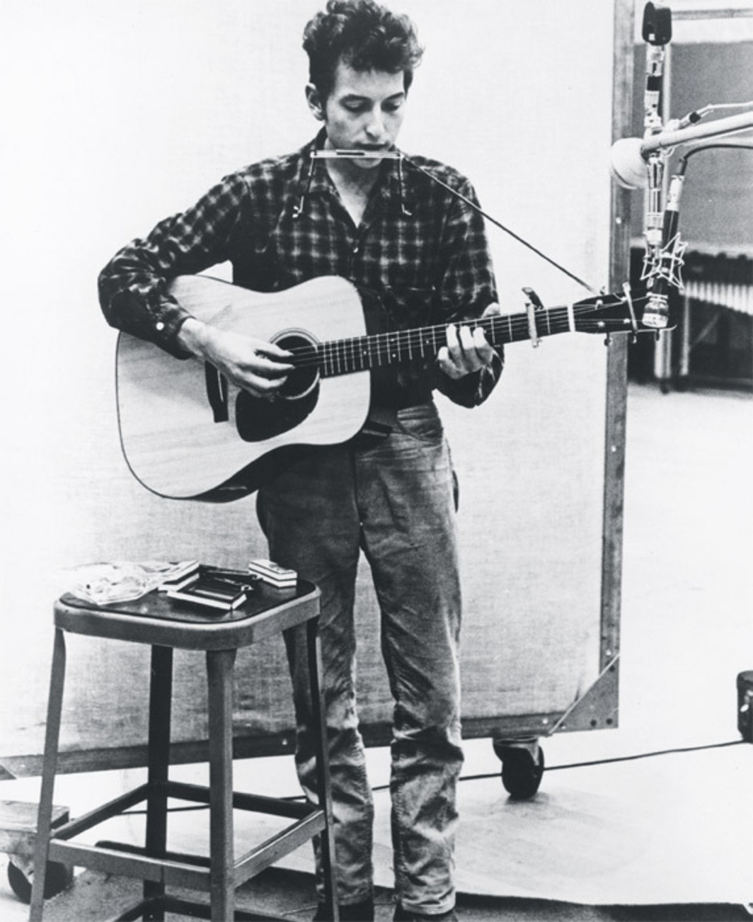 Bob Dylan in the studio, ca. 1962. Photo: Michael Ochs Archives/Getty Images.