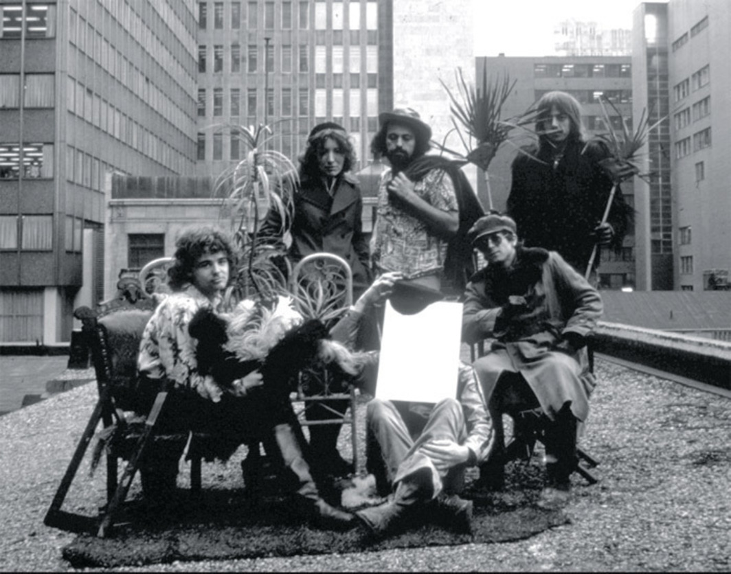 General Idea, on the roof of their loft, 87 Yonge Street, Toronto, 1970. Back row, from left: Granada Gazelle, Jorge Zontal, Felix Partz. Front row, from left: AA Bronson, unknown (behind mirror), Daniel Freedman.