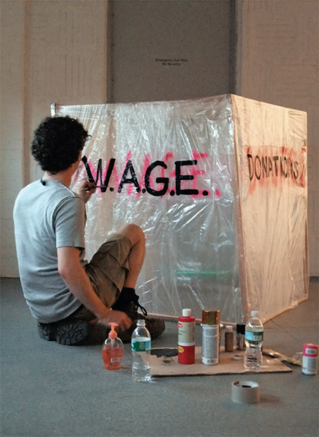 Dean Daderko preparing a complaint, suggestions, and donation box for W.A.G.E.'s booth at No Soul for Sale: A Festival of Independents, X Initiative, New York, June 22, 2009.