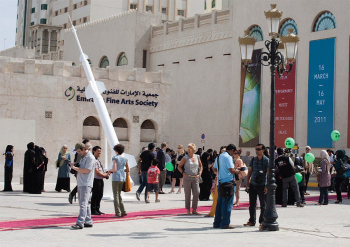 Entrance of the Sharjah Art Museum with Joana Hadjithomas and Khalil Joreige's Lebanese Rocket Society: Elements for a Monument, 2011, opening day of Sharjah Biennial 10, UAE, March 16, 2011.