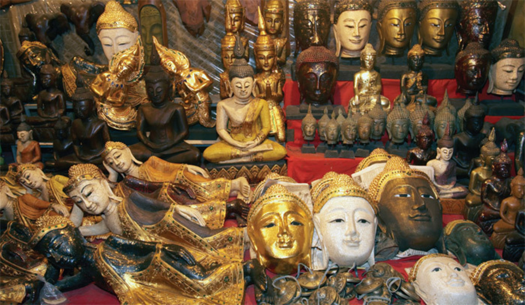 *Buddhas for sale at a stall in the night market, Chiang Mai, Thailand, 2010.* Photo: Grant Rooney/Super Stock.
