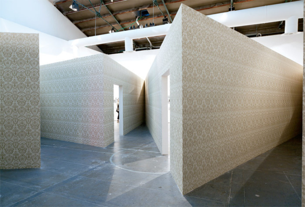 "Monika Sosnowska, Antechamber, 2011, projections, wallpaper, skirting board, stucco, doors, lamps. Installation view, Central Pavilion, Venice. From ""ILLUMInations."" Photo: Kate Lacey."